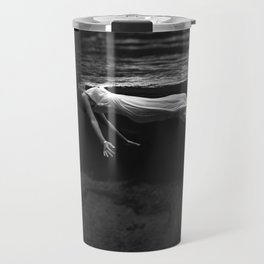 Underwater view of a woman floating in water Travel Mug
