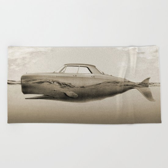 the Buick of the sea Beach Towel