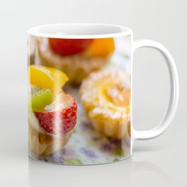 Small fruit tarts laid out on an antique china plate Coffee Mug