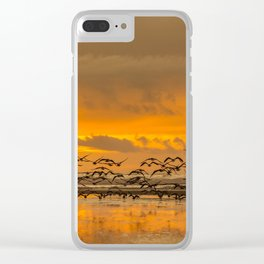 Seagulls Fly into the Ocean Sunset in Yachats, Oregon Clear iPhone Case