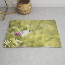 Butterfly on a spring flower Rug
