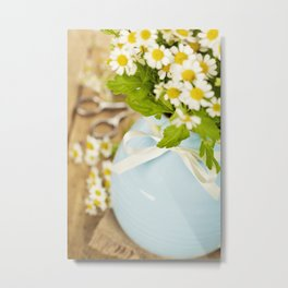 Beautiful flowers in a vase on an old table Metal Print