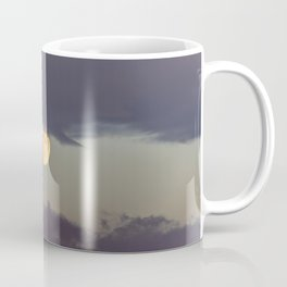 Moon surrounded by clouds Coffee Mug