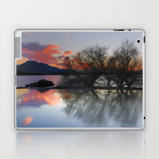 Trees in the water at the red sunset Laptop & iPad Skin
