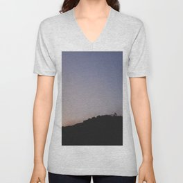 Male silhouetted on mountain top at sunset. Derbyshire, UK Unisex V-Neck