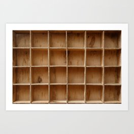 Empty wooden cabinet with cells Art Print