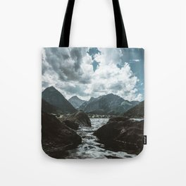 Mountains under cloudy sky Tote Bag