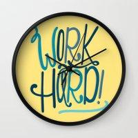 work hard Wall Clocks featuring Work Hard! by Chelsea Herrick