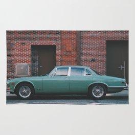Vintage Car On The Street Rug