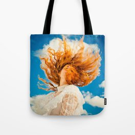 woman whipping Red hair around on a beautiful sunny day wearing a lace dress Tote Bag