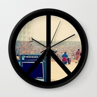 woodstock Wall Clocks featuring Woodstock 69 by Silvio Ledbetter