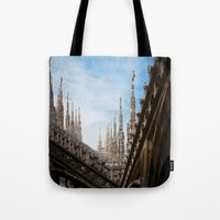 spires Tote Bags featuring Duomo di Milano spires by Marc Daly