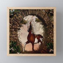 Wonderful horse comes through a gate Framed Mini Art Print