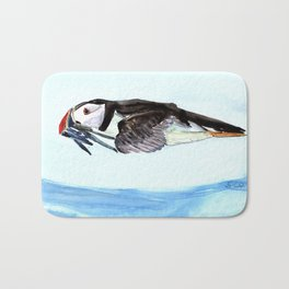 Atlantic Puffin flying over the ocean Bath Mat