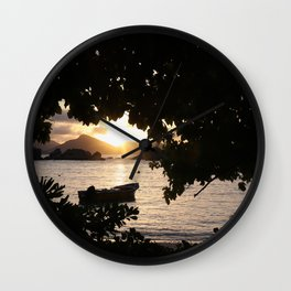 Sunset framed by leafs Wall Clock