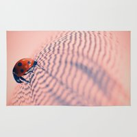 beetle Area & Throw Rugs featuring beetle by Tanja Riedel