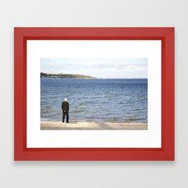 Staring at the sea Framed Art Print