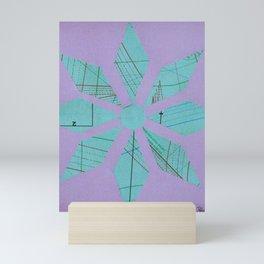 A tailor's flower Mini Art Print