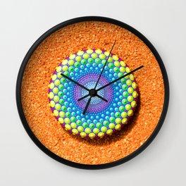 Beautiful hand painted Mandala stone on orange background Wall Clock