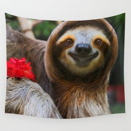 Happy sloth eating hibiscus flowers Wall Tapestry