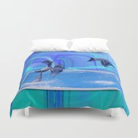 dolphins Duvet Covers featuring Leaping Dolphins by Roger Wedegis