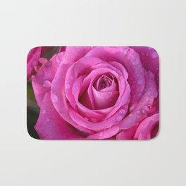 Pink rose close up with raindrops Bath Mat