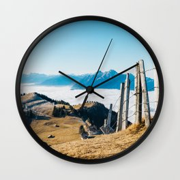 Alpine Peaks Sticking Out of Sea of Fog Wall Clock