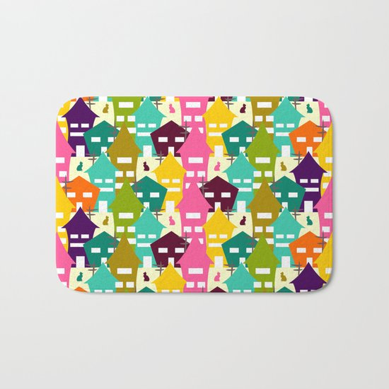 Colorful houses and cats Bath Mat