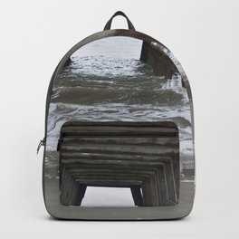 Under the fishing pier with waves Backpack