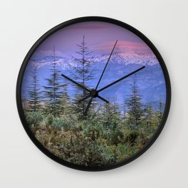 Sierra Nevada at sunset. Purple clouds Wall Clock