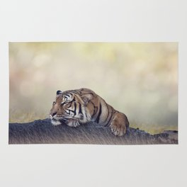 Bengal tiger resting on a rock Rug