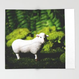 A white sheep in the forest Throw Blanket