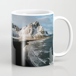 Aerial of a black beach at the ocean with Mountain in south Iceland during sunset - Landscape Photog Coffee Mug
