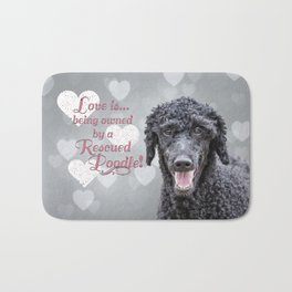 Love is being owned by a rescued poodle Bath Mat
