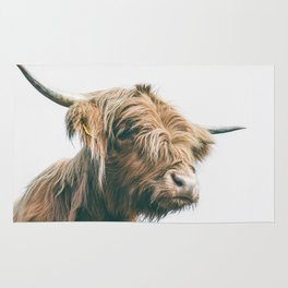 Majestic Highland cow portrait Rug