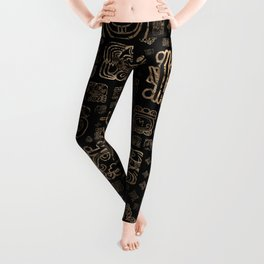 Mayan glyphs and ornaments pattern -gold on black Leggings