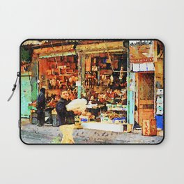 Aleppo: a man with packages passes in front of a shop Laptop Sleeve