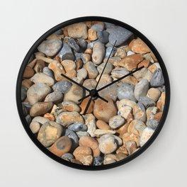 Pebbles on the beach Wall Clock