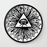 all seeing eye Wall Clocks featuring All seeing camera eye by dsimpson