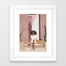 Woman sitting on the porch Framed Art Print