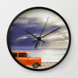 orange classic car on the sandy beach with beautiful sky and beach background Wall Clock