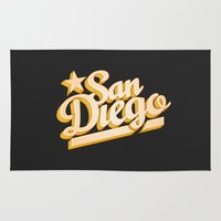 san diego Area & Throw Rugs featuring San Diego by GetSolidGold
