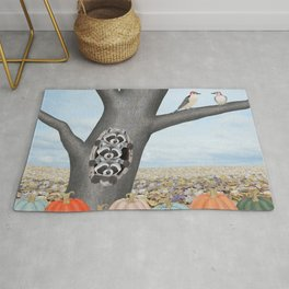 red bellied woodpeckers, heirloom pumpkins, and raccoons in a tree Rug