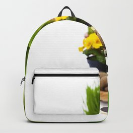 Spring flowers and garden tools  isolated on white Backpack