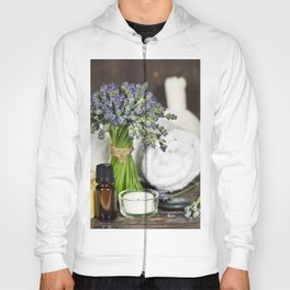 Fresh  lavender flowers, zen stones, essential oil, candle and towel over wooden surface Hoody