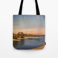 will graham Tote Bags featuring Autumn at Lake Graham by Jai Johnson