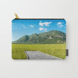 Beautiful mountain scenic with wooden footpath in field under sunlight Carry-All Pouch