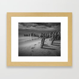 Footprints and Pilings on the Beach in Black and White at Kirk Park by Grand Haven Michigan Framed Art Print