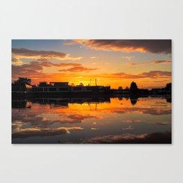 Sunrise arcross the water Canvas Print
