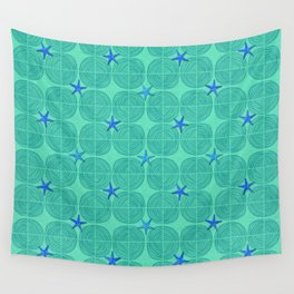 Blue starfish on green sand Wall Tapestry